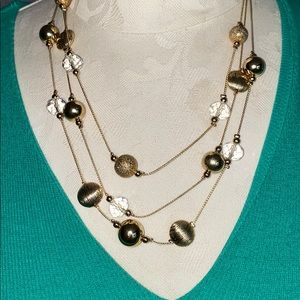 Gold and crystal layered necklace and earrings